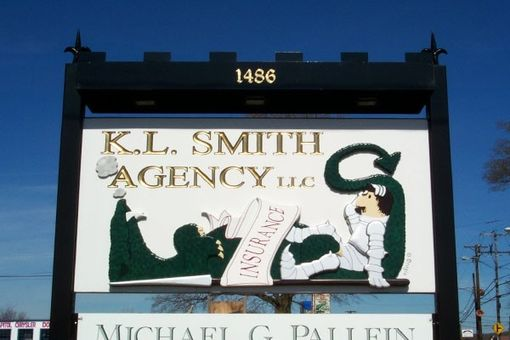 Custom Made Custom Carved Sign With Metal Castle Framing: K.L. Smith Insurance Agency