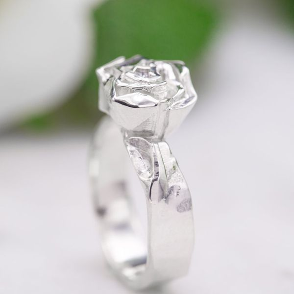A bit like origami, but heartwarmingly inspired by the folded-foil ring he once created for her.