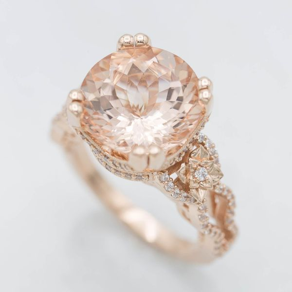 For this design, our artists tried to capture this customer's love of vintage detailing and floral ornamentation. Over 100 sparkling accent gems surround the nearly 7ct center stone.