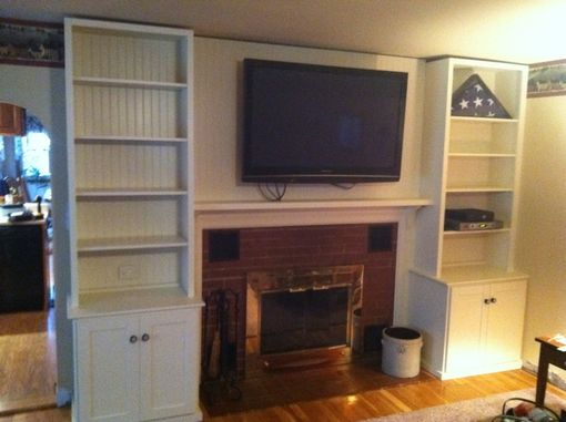 Custom Made Fire Place Cabinets, Bookcases, And Mantle.