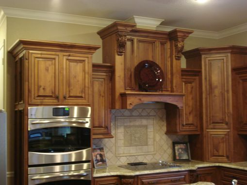 Custom Knotty Alder Stepped Kitchen By Creative Cabinetry