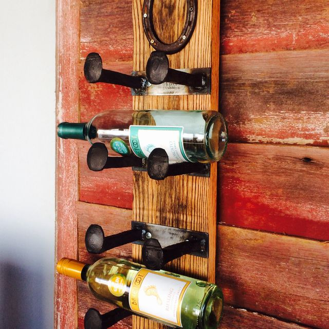 A Hand Crafted Railroad Spike Wine Rack With Lucky Horseshoe Made To Order From Virginia Build Works Custommade Com