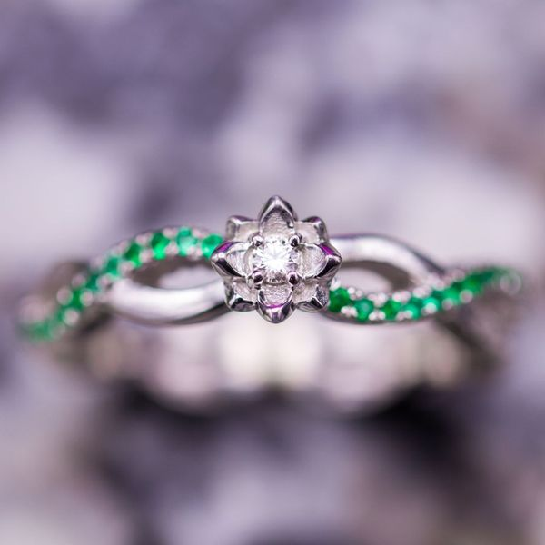 A dainty lotus setting on a vining shank. Subtle and perfect for a promise ring.