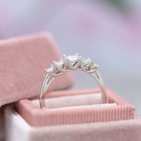 This five-stone ring uses a beautiful trellis setting visible from the side of the ring.