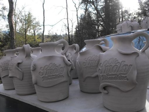 Custom Made Logo Xxx Jugs And Mugs For Ole Smoky Moonshine Distillery.