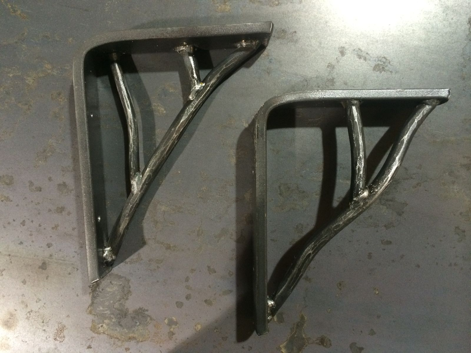 Hand Crafted Forged Organic Shelf Brackets By Iron