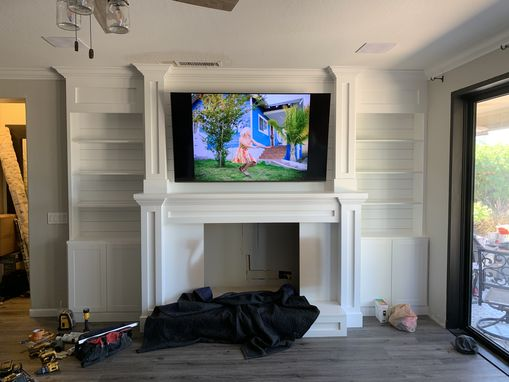 Custom Made Fireplace Built-In With Bookcases