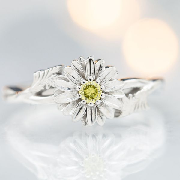 This bright, daisy ring has a canary yellow diamond at the heart of the flower.