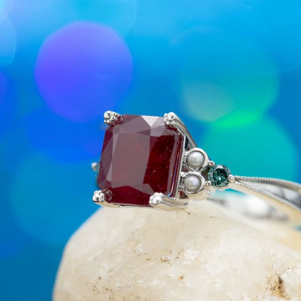 We set this customer's heirloom ruby with puppy paw prongs for a cute, personal touch.