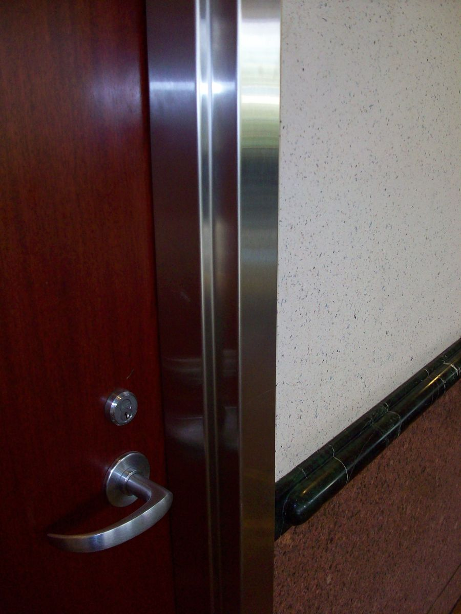 Custom Made Stainless Steel Cladding Of An Existing Door
