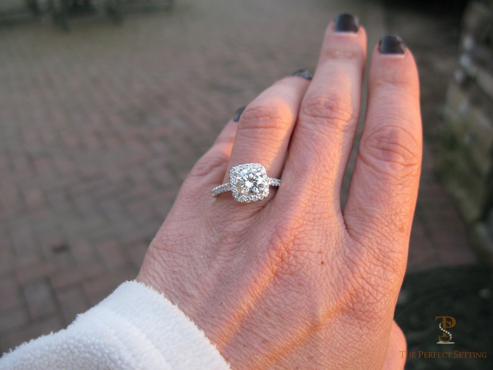 hand crafted cushion halo engagement ring with round