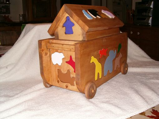 Custom Made Toy Ark With All The Animals. The Animala Will Punch Out And Fall Inside Of The Ark And Top Cmes Off To Get The Animals Out  Sothey Can Be Put Back In Thier Places. It All So Has Wheels So It Canbe A Pull Toy..