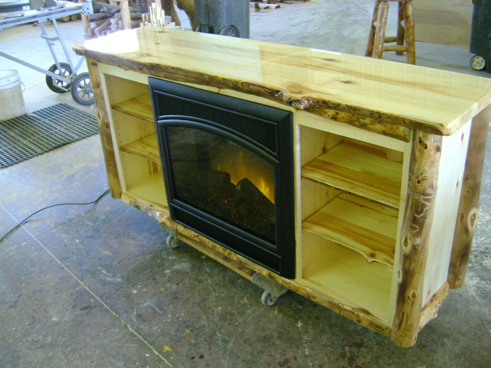 custom aspen log tv stand with a built in electric fire place by ireland 39 s wood shop. Black Bedroom Furniture Sets. Home Design Ideas