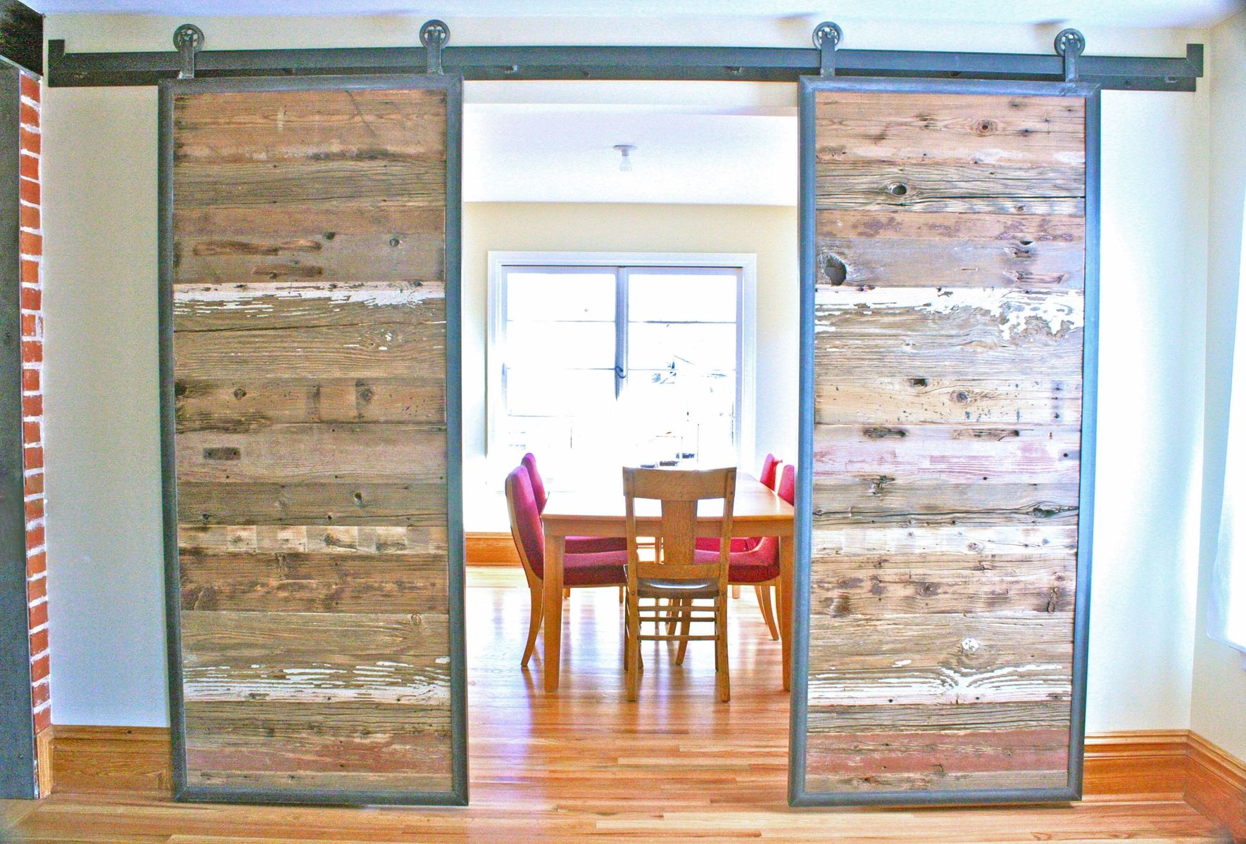 Handmade industrial reclaimed barn doors on steel track by for Recycled interior doors