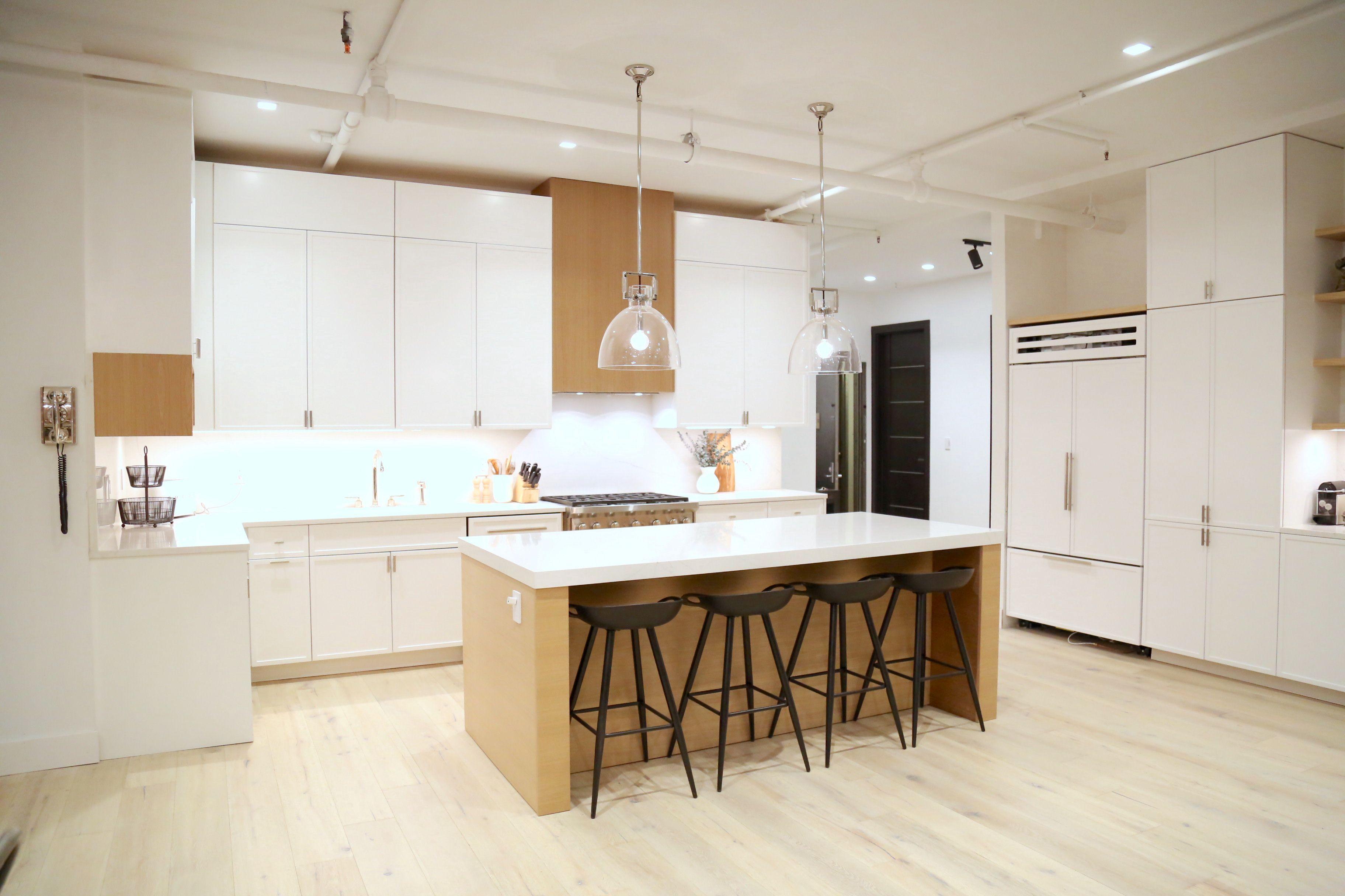 - Custom White Shaker Cabinets Over Rift White Oak Floating Shelves