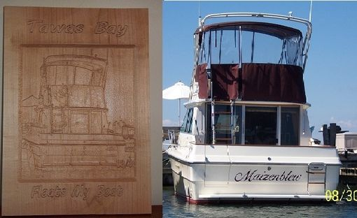 Custom Made Wood Carving Of A Picture Of A Customer's Boat On Tawas Bay