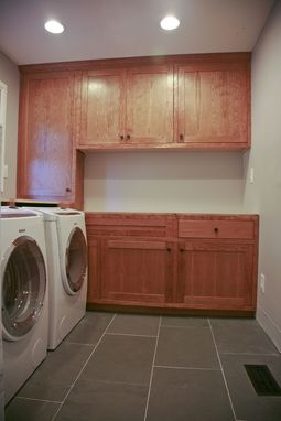 Custom Made Cherry Laundry Room Cabinets