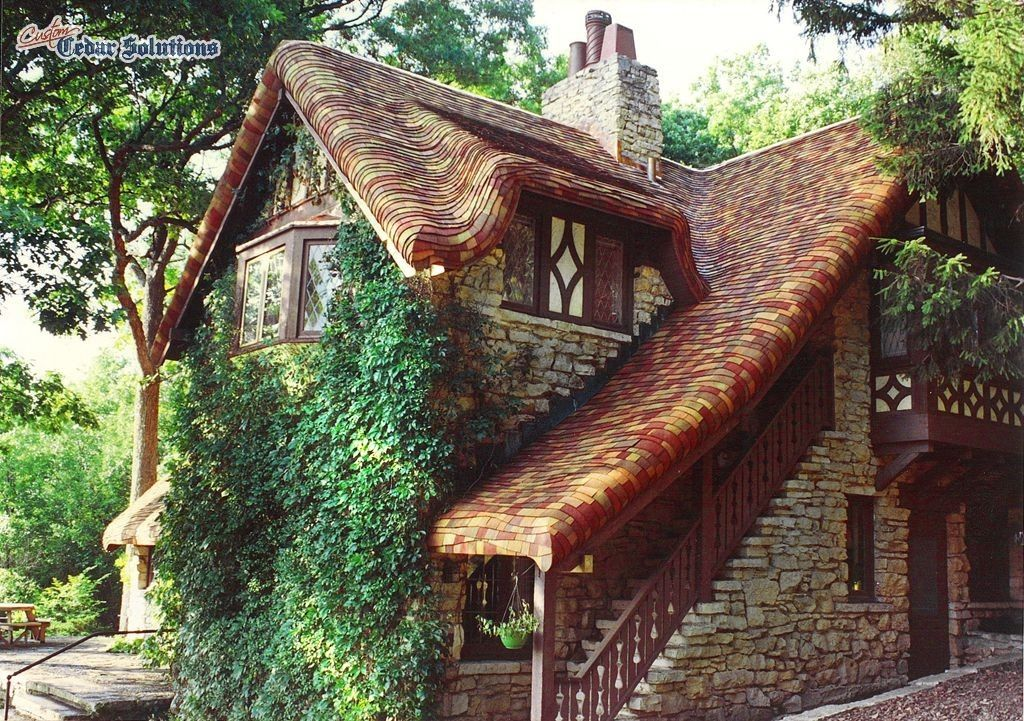 Hand crafted gingerbread roof using cedar shingles on a Custom cottage homes