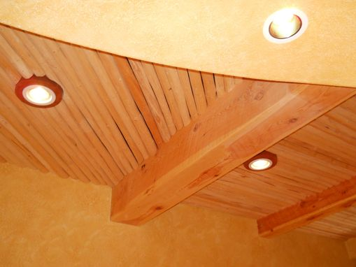 hand made beam and latilla ceiling with cherry light trims