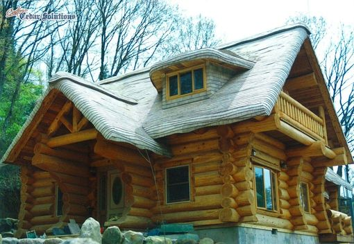 Custom Made Stained Cottage Roof On Log Home