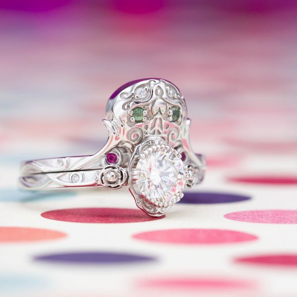 A whimsical bridal set with a sugar skull motif, a diamond set in the gaping maw of the the skull.
