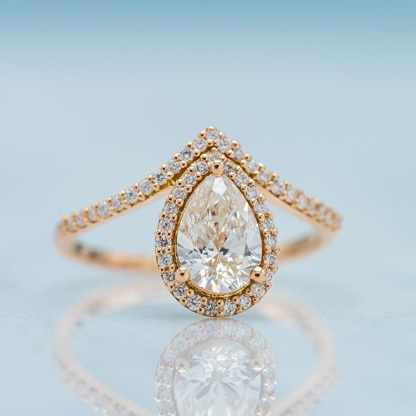 The rose gold setting's metal color masks any off color in this 1.01ct I color pear brilliant diamond.