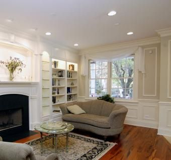 Custom Made Walcott Fire Mantle With Floor To Ceiling Book Shelves.