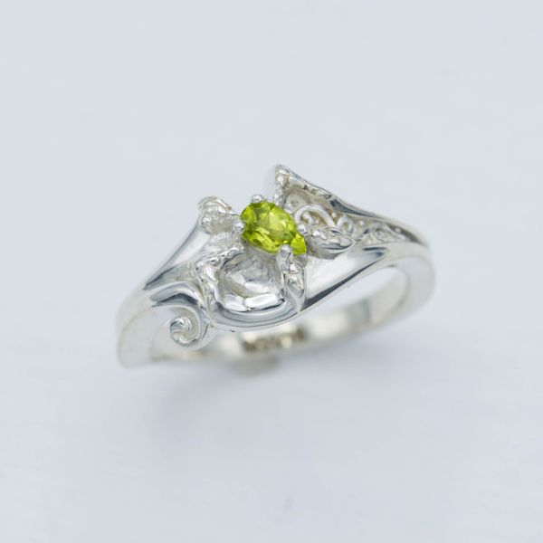 This turtle-inspired engagement ring sets a pear cut peridot as the turtle's shell.