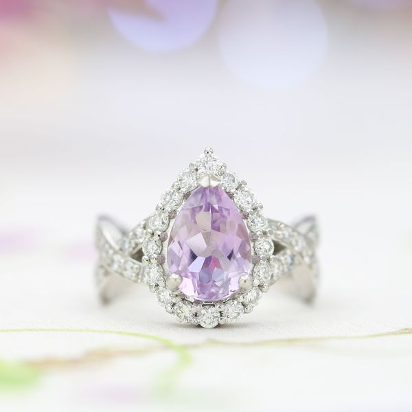 A pear cut rose de France engagement ring with a twisting platinum shank and loads of diamond sparkle.