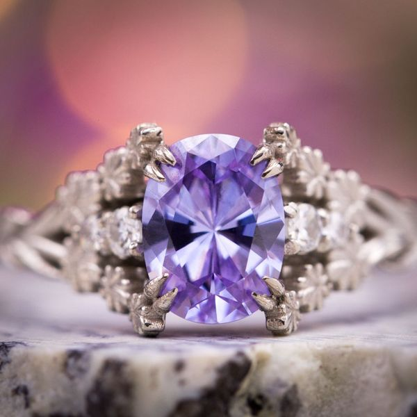 This flower-themed engagement ring is inspired by lavender and sets a cubic zirconia that perfectly suits the flower.