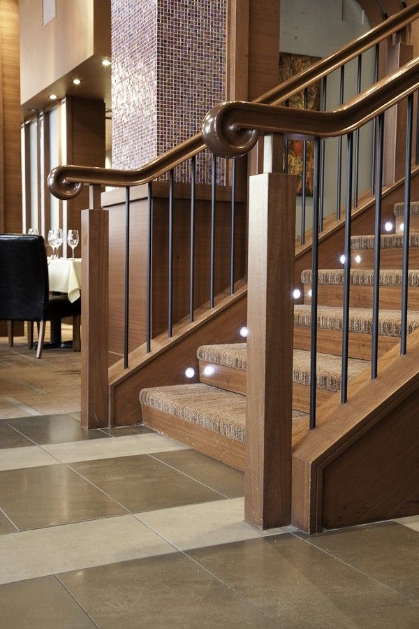 Custom Made Wood Stair Railing Enhances Upscale Restaurant