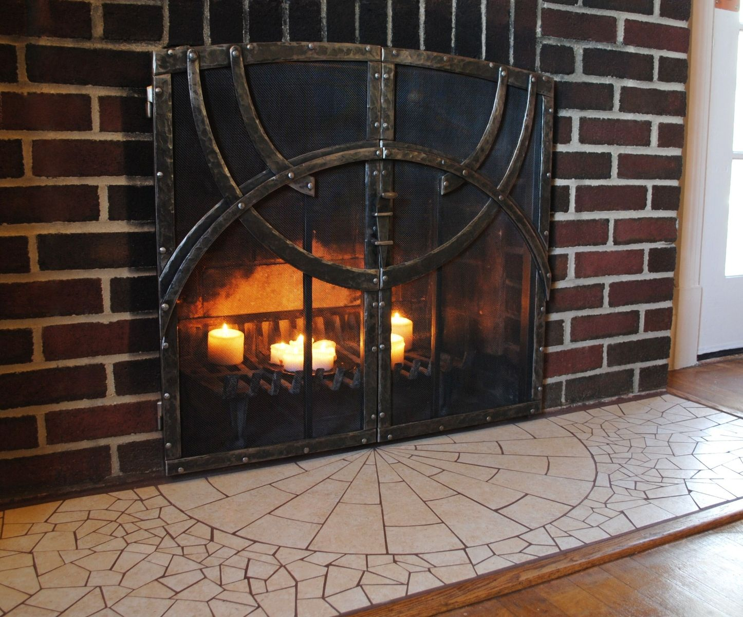 custom hand forged fire screen and mosaic hearth by phoenix