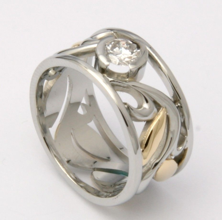 custom made white and yellow gold wedding band with vine design