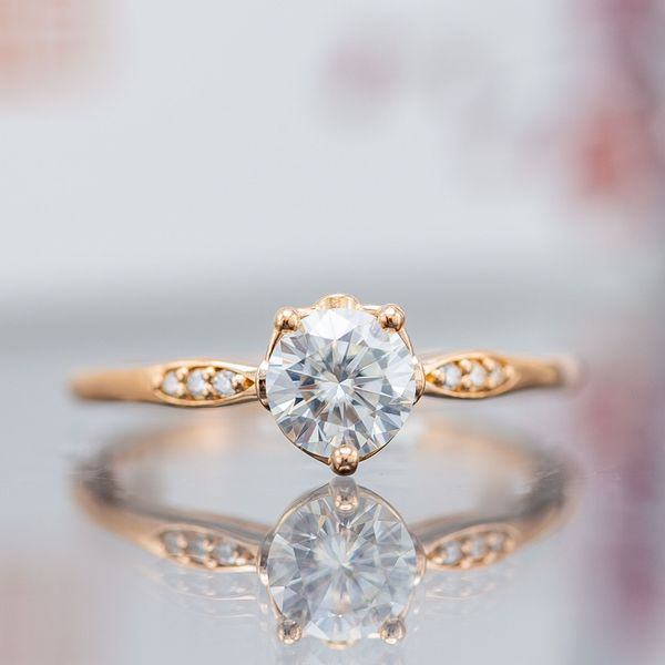 For a more delicate, unique look, this engagement ring uses a three-prong setting.