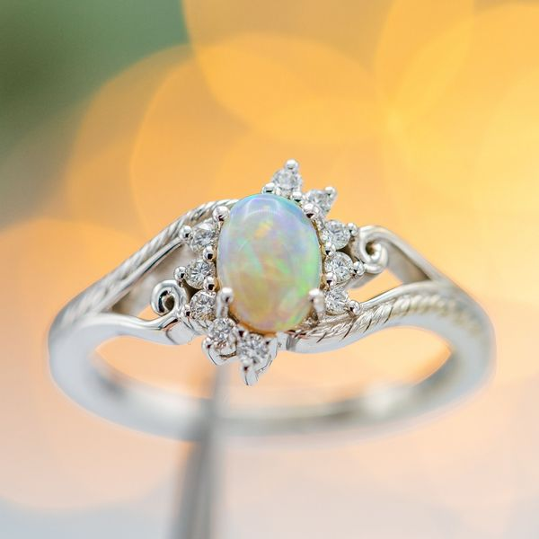 Diamonds are almost never cut in a cabochon shape, but the smooth domed design is common for many colored and semi-transparent gems like this opal.