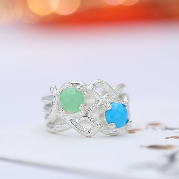 This two stone branch engagement ring pairs a cabochon cut chrysoprase with turquoise.