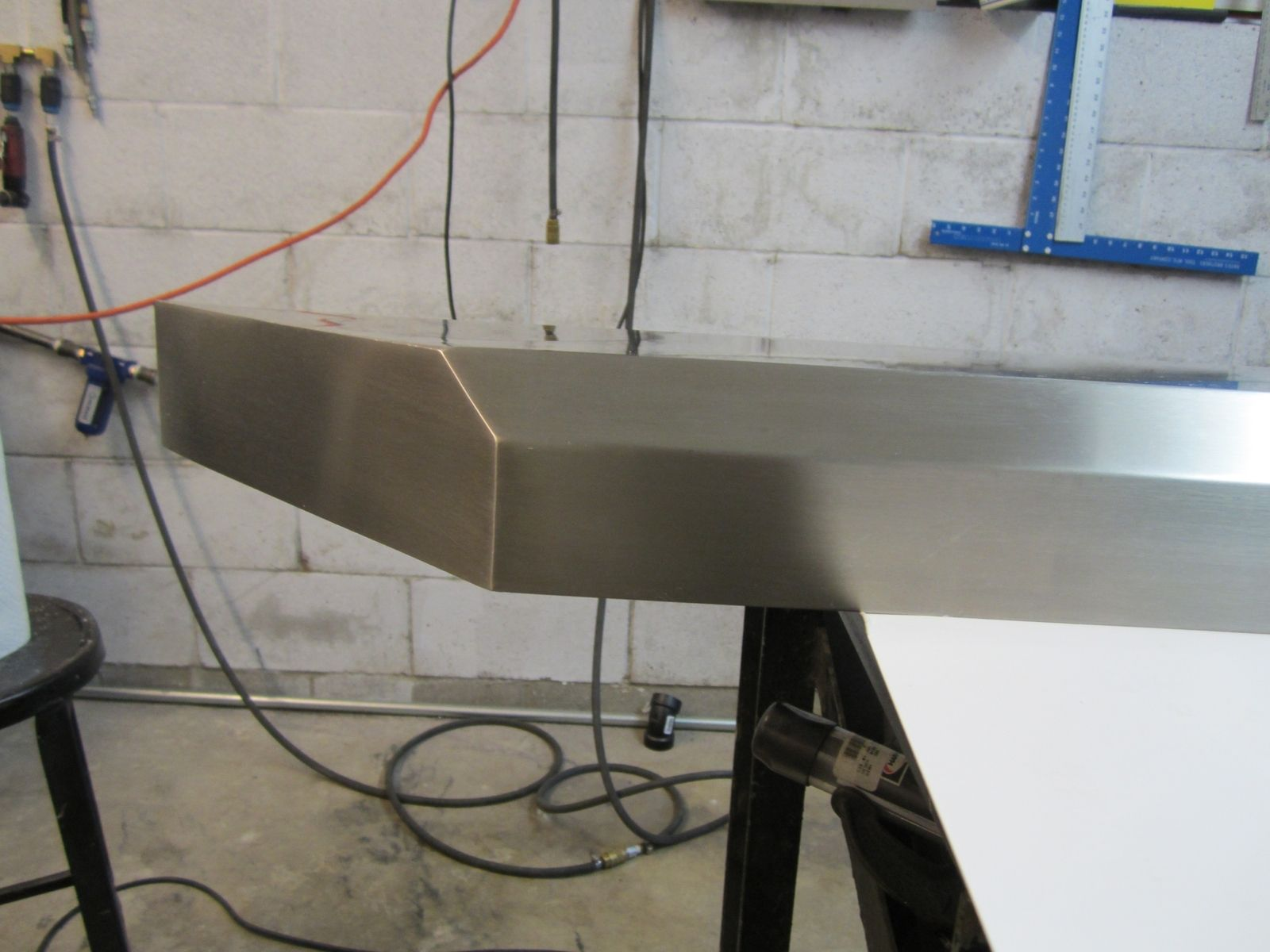 custom brushed stainless steel fireplace mantels and shelving by