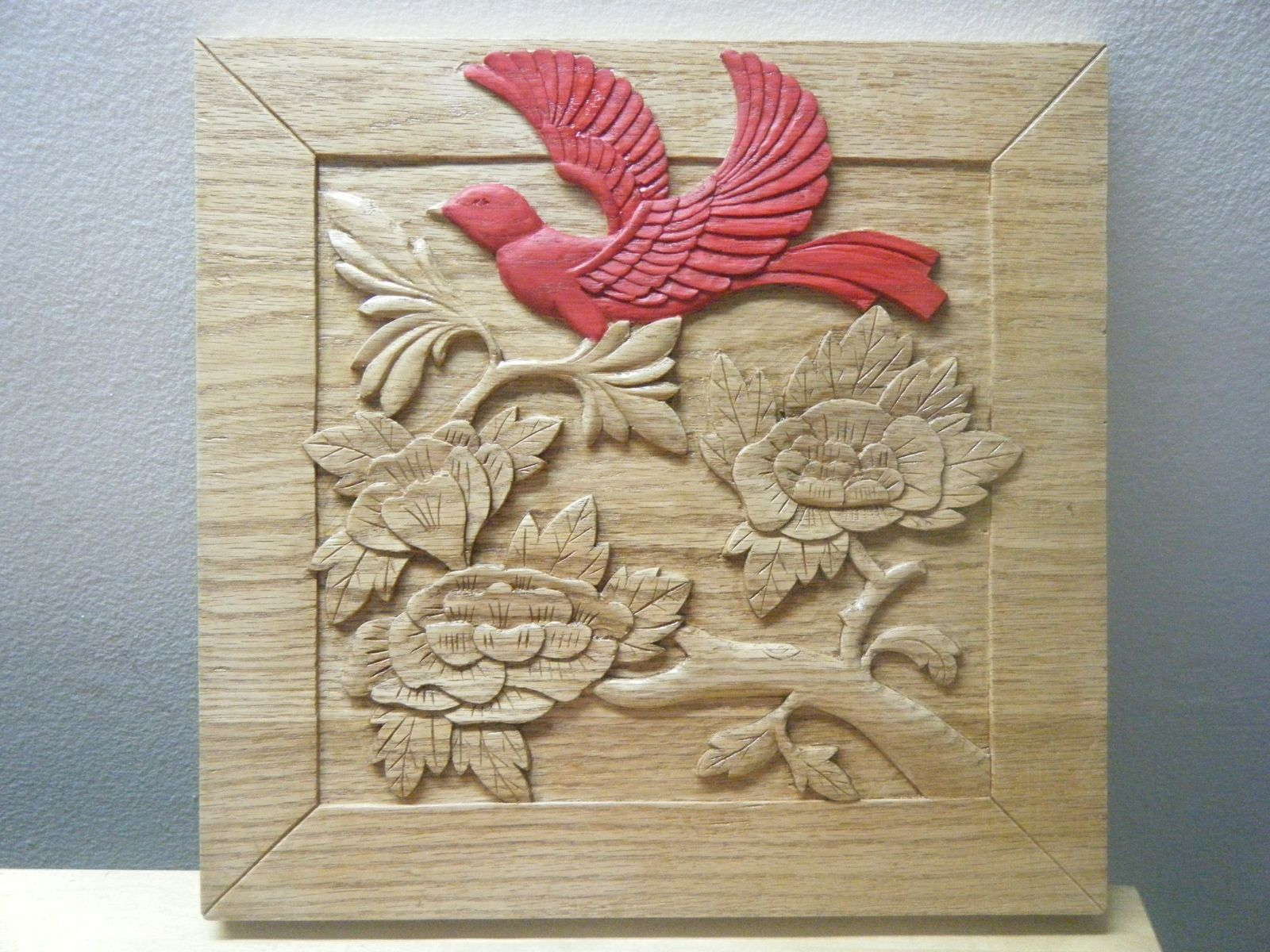 Hand made red bird relief carving by ehandcarved