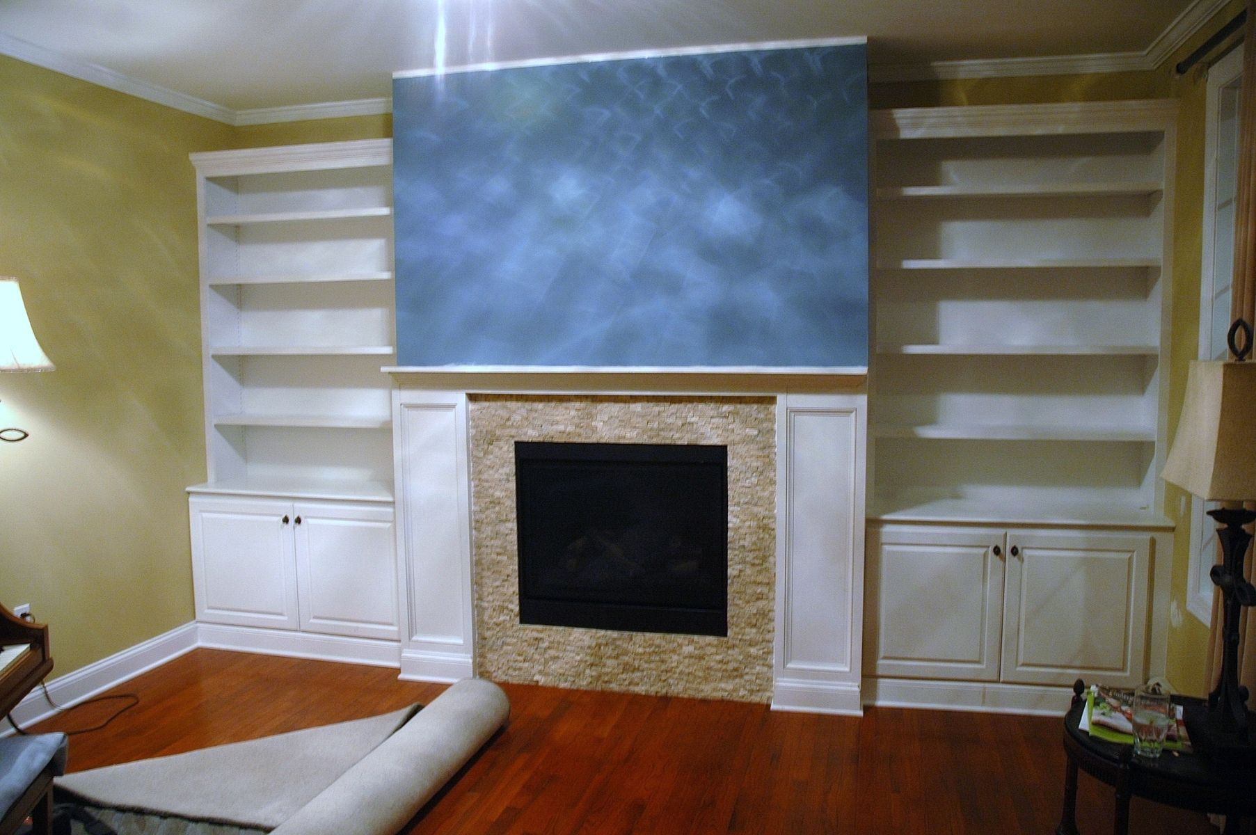 handmade built in bookcases base cabinets and fireplace surround