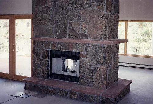 Custom Made Upstairs / Downstairs Moss Rock Fireplace