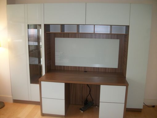 Custom Made Custom Home Office Solution - Large Desk With File Drawers, Closed Door Storage, Pop-Up Doors, And Open Display Storage In A Walnut Finish With Icicle Glass Overlay