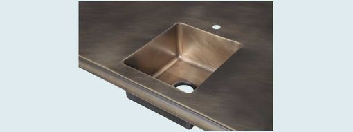 Custom Made Bronze Countertop With Integral Sink
