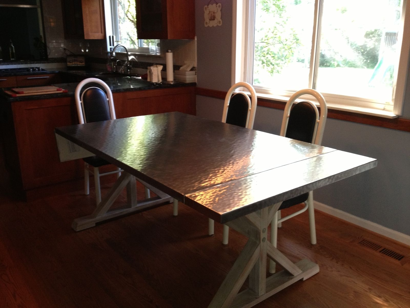 Handmade custom hammered stainless steel dining table by for Dining room tables handmade