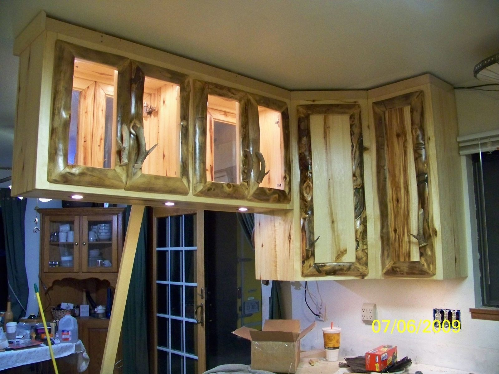 Hand made rustic aspen log kitchen cabinets and built in for Custom built kitchen cabinets