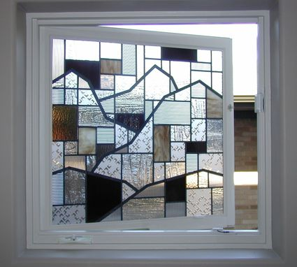 Custom Made Stained Glass In A Window That Opens