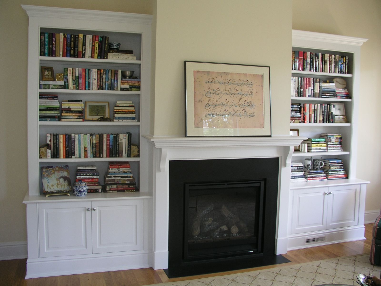 custom made painted fireplace cabinetry and mantle by tony o