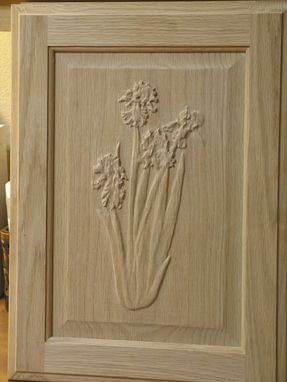 Custom Made Flower Carvings On Cabinet Doors.