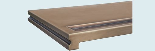 Custom Made Bronze Countertop With Integral Drink Rail