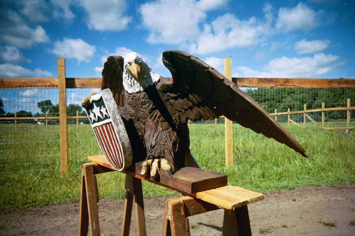 Custom made chainsaw carvings birds by artisans of the valley