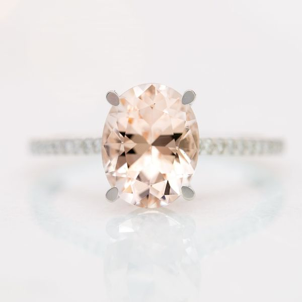 Peachy-pink morganite in a sleek, white gold, pave shank.